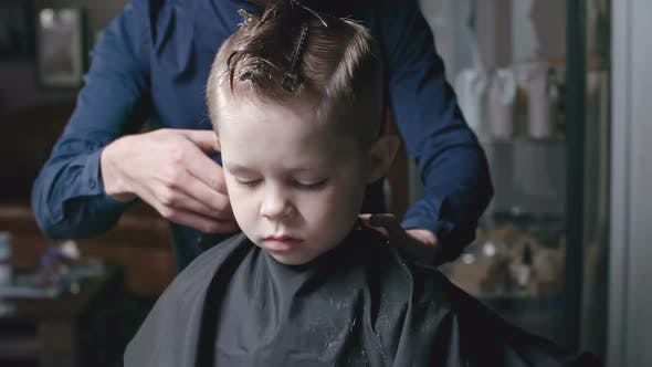 Cover Image for Barber Trimming Hair of Young Boy