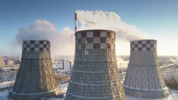 Thumbnail for Aerial View Large Cooling Towers Produce White Steam