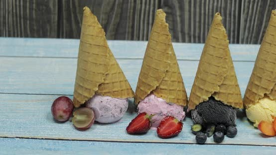 Thumbnail for Sweet Ice Cream in Balls in a Waffle Cone Different Flavors Berries and Fruits