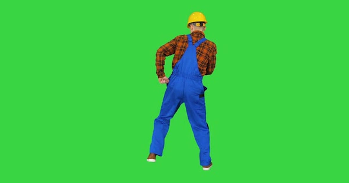 Construction Worker in Helmet Dancing on a Green Screen, Chroma Key