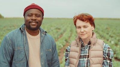 Portrait of Black Man and Caucasian Woman in Farm Field
