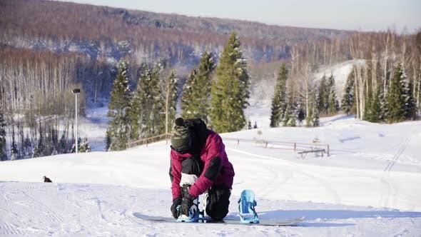 Thumbnail for Man Locking the Mounts of Snowboard Standing on the Snowy Slope. Winter, Sport, Holidays, Xmas