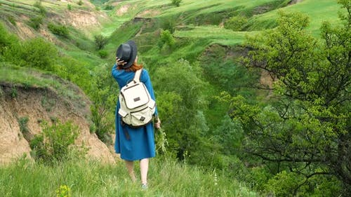 Girl Looking At The Ravine