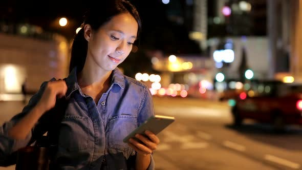 Thumbnail for Woman Looking at Mobile Phone at Night