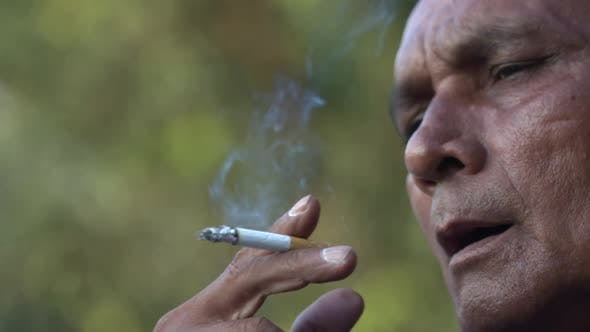 Asian Indian Man Smoking A Cigarette In SloMo