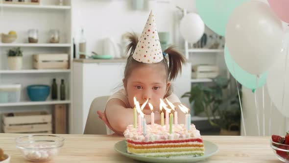 Thumbnail for Sad Girl with Down Syndrome Having Birthday Party