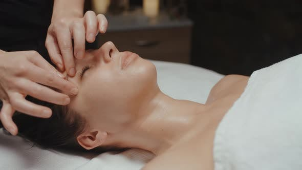 Thumbnail for Caucasian Woman Receiving Facial Massage in Spa Skin Care Face Treatment Rejuvenation Procedure