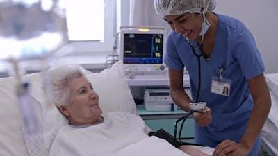 Nurse Taking Patient Blood Pressure