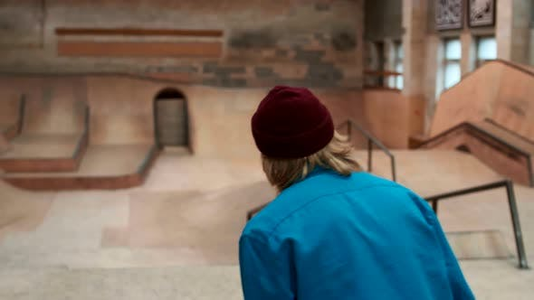 Thumbnail for Unrecognizable Teenage Boy Is Skateboarding Indoors