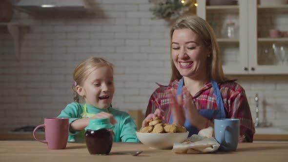 Thumbnail for Mom and Child Eating Homemade Cookies in Kitchen