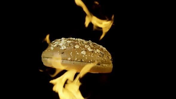 Close up of rotating burger bun in fire