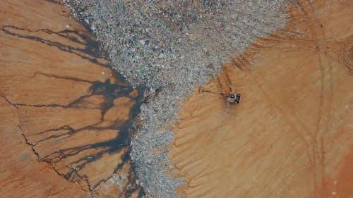 Aerial excavator at landfill site