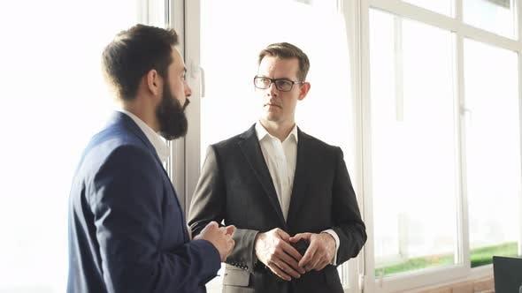 Two Successful Confident Business Men Have Conversation