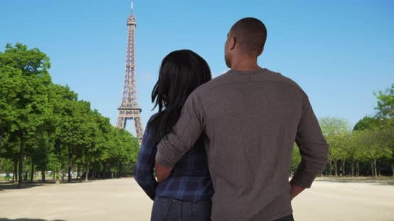 Thumbnail for Youthful black couple in love enjoy view of Eiffel Tower together