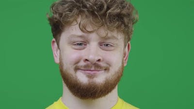 Portrait of a Man with Gray Eyes on Green Screen in Studio