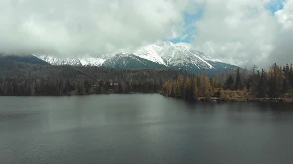 Thumbnail for Aerial View of Strbske Pleso in the Clouds and Snowy Mountains. Slovakia