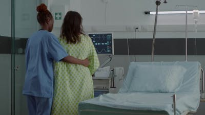 African American Nurse Supporting Pregnant Adult