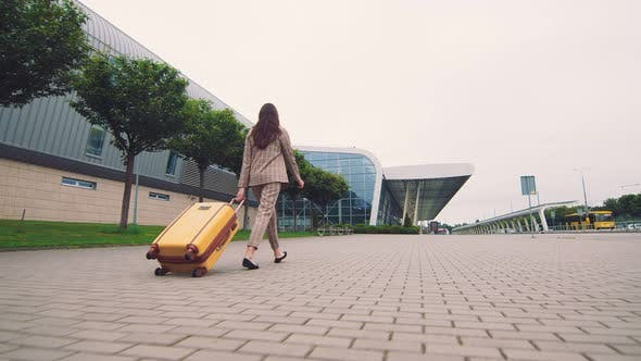 Thumbnail for Woman Walking with Luggage. The Girl Goes on a Journey and Walks To the Airport. A Businesswoman