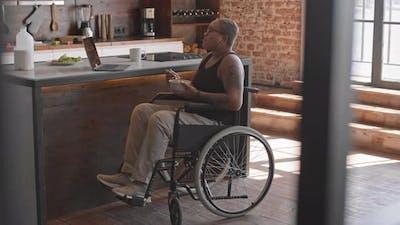 Woman in Wheelchair Eating Breakfast