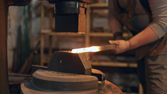 Blacksmith Pulls Metal on the Equipment