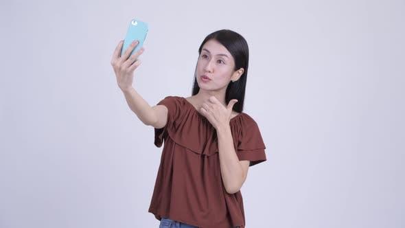 Thumbnail for Happy Beautiful Asian Woman Taking Selfie