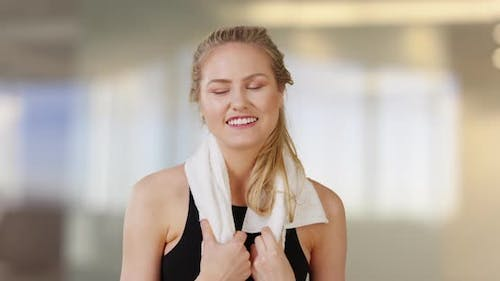 Beautiful caucasian woman smiling in obscure gym office