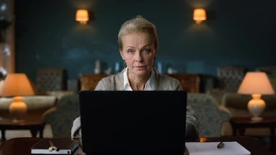 Calm Old Woman Working Laptop at Home