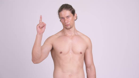 Thumbnail for Serious Muscular Shirtless Man Pointing Up