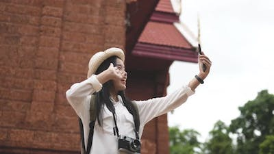 Traveler woman video call with friends