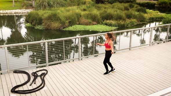 Aerial shot of a woman working out in the park