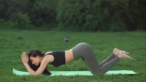 Cover Image for Woman Practicing Yoga Outdoors in Park