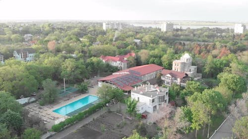Health-improving resort complex near sea. Hotel complex with swimming pool from birds eye view