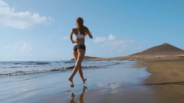 Thumbnail for Beautiful Sportive Woman Running Along Beautiful Sandy Beach, Healthy Lifestyle, Enjoying Active