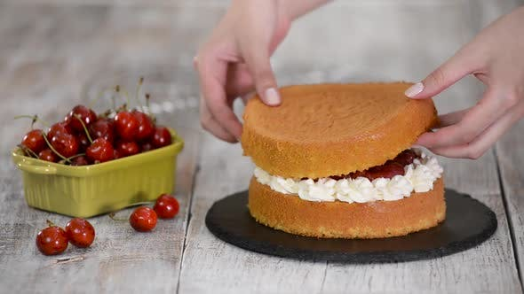 Thumbnail for Woman Making The Naked Cherry Cake With Vanilla Cream
