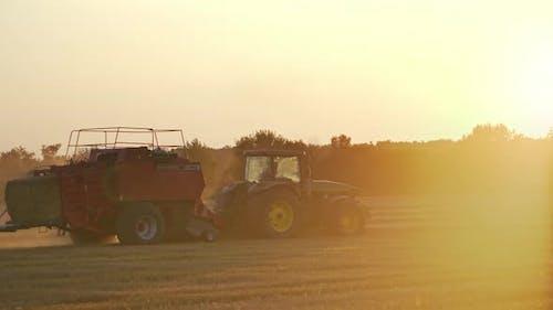Baling haystack with a hay baler