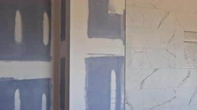 Renovation Construction of Master Bathroom with New Under Construction Bathroom Interior Drywall