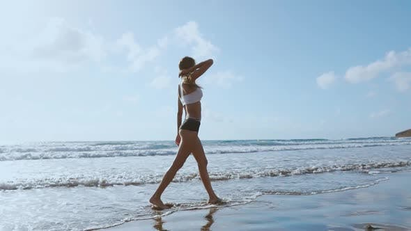 Thumbnail for Woman Bare Foot Walking on the Summer Beach. Close Up Leg of Young Woman Walking Along Wave of Sea