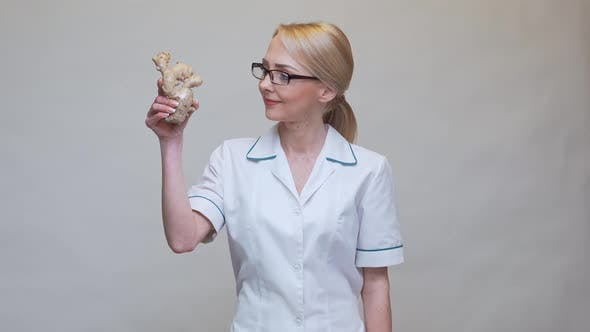Nutritionist Doctor Healthy Lifestyle Concept - Holding Ginger Root