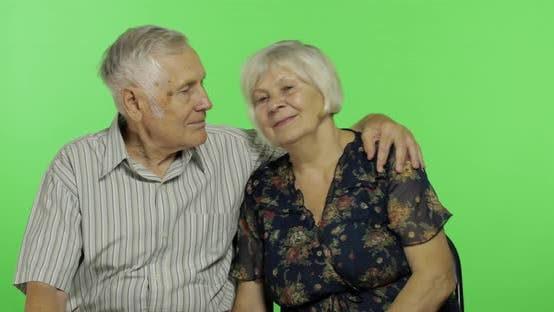 Thumbnail for Funny Senior Aged Man and Woman Sitting Together. Concept of a Happy Old Family