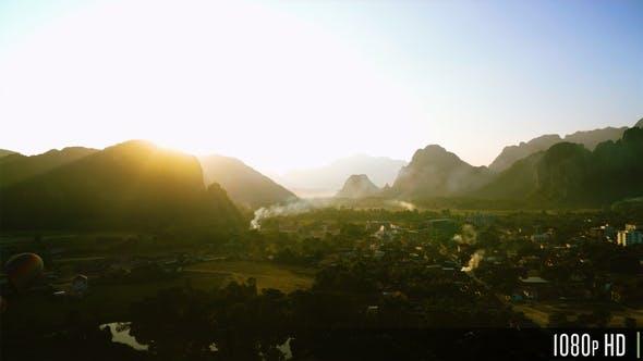 Thumbnail for Aerial View of Dramatic Sunset along Mountainous Peak