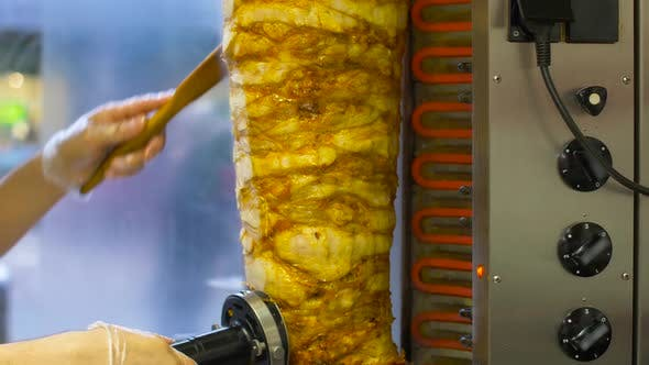 Thumbnail for Chef Slicing Doner Meat From Spit at Kebab Shop 7