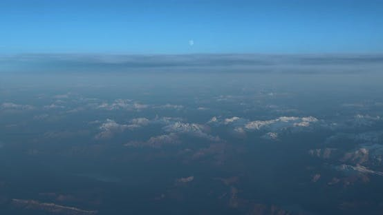 Thumbnail for Beautiful View Through Airplane Window, Airplane Flying Above the Mountains with Clouds.