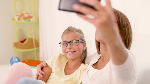 Happy Family Taking Selfie By Smartphone at Home 41