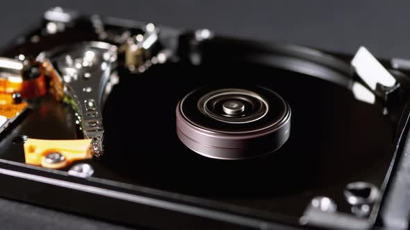 Hard Disk Drive Inside. Structure of HDD, Spinning Platter. Move Magnetic Head by RoStRecords on Envato Elements