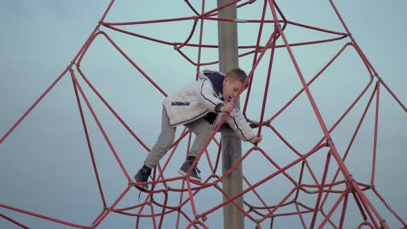 Thumbnail for A Boy on a Red Climbing Web