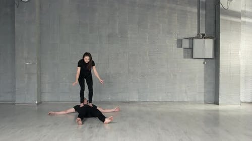 Young Couple of Dancers Training in Studio