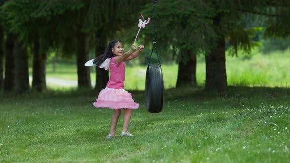 Thumbnail for Girl in fairy princess costume on tire swing, shot on Phantom Flex 4K