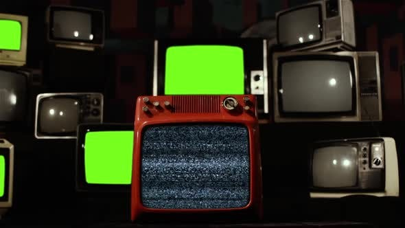 Cover Image for Stacks of Old TVs with Green Screen and Bad Reception.