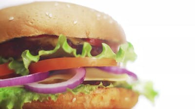 Big and Tasty Burger is Rotating on the Plate
