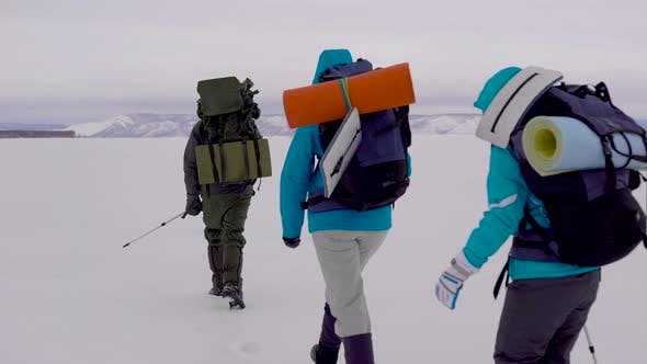 Thumbnail for Four Young People Go Hiking in the Snowy Desert